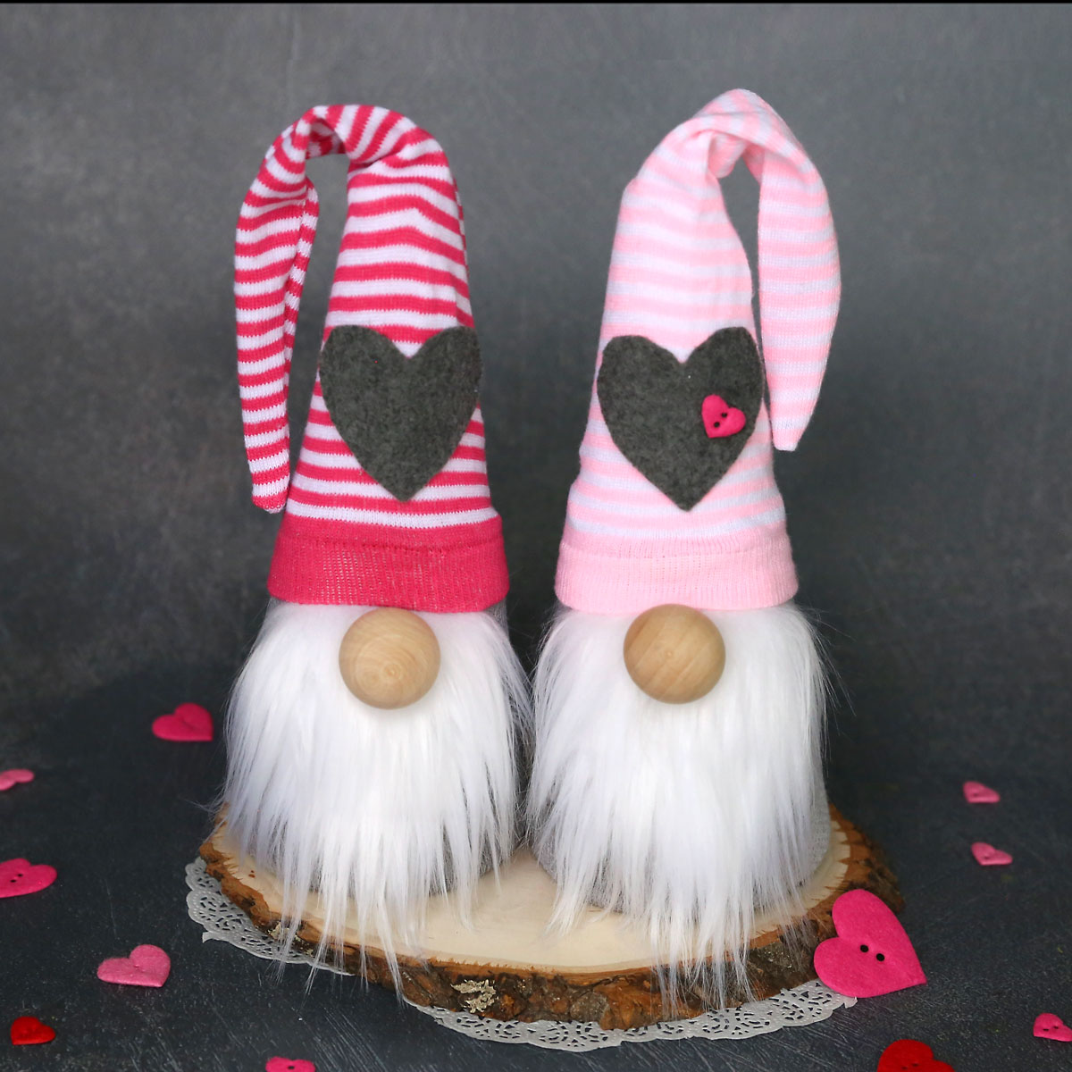 DIY sock gnomes with pink and white striped hats with hearts on them