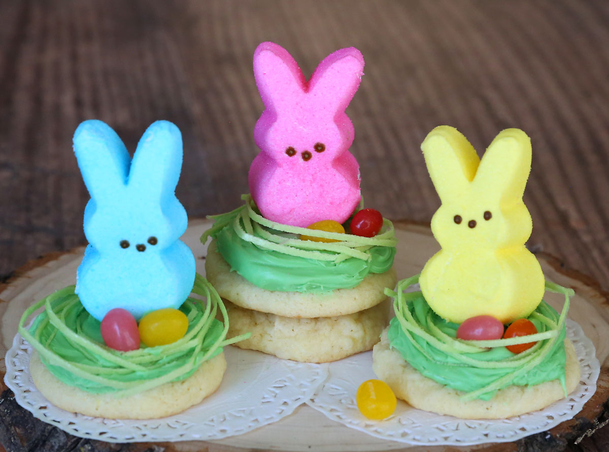 Sugar cookies topped with edible Easter grass and a peeps bunny