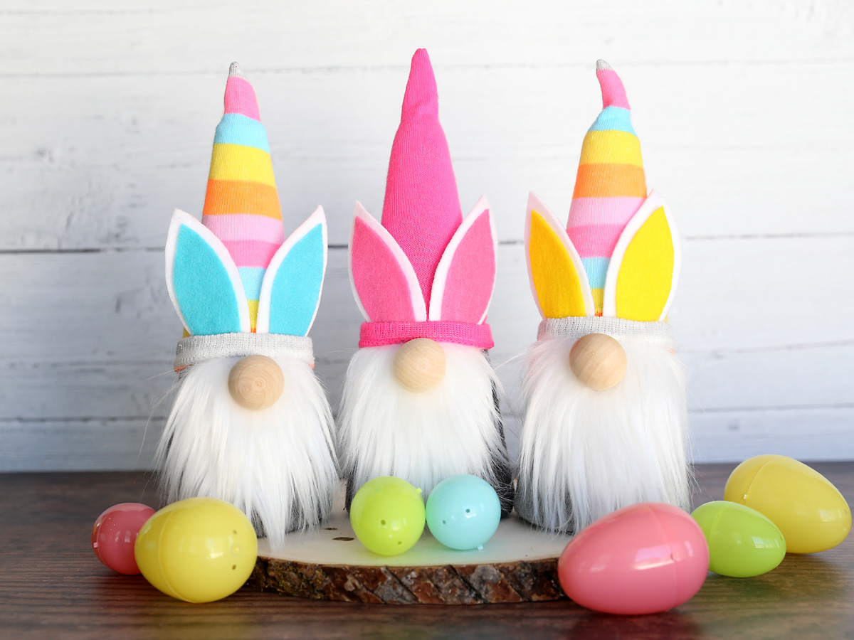 Three DIY Easter gnomes with plastic Easter eggs