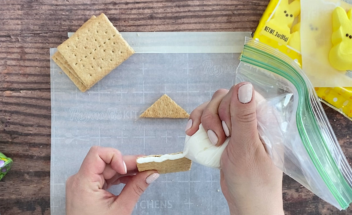 """How to make a peeps house: use royal icing to """"glue"""" pieces together"""