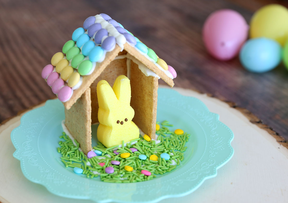 House for an Easter bunny Peeps made from graham crackers and frosting, on a plate