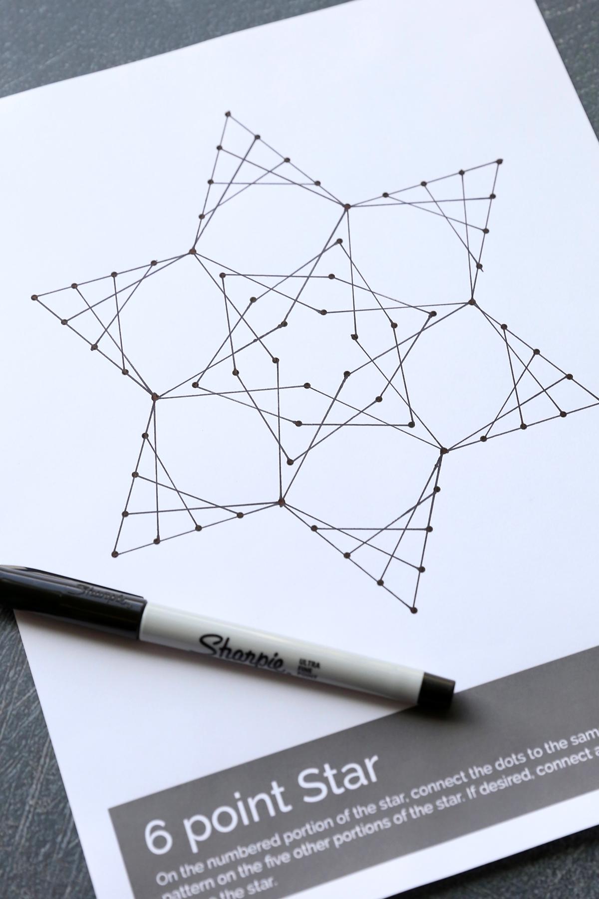 Printable line art worksheet filled in to create star design
