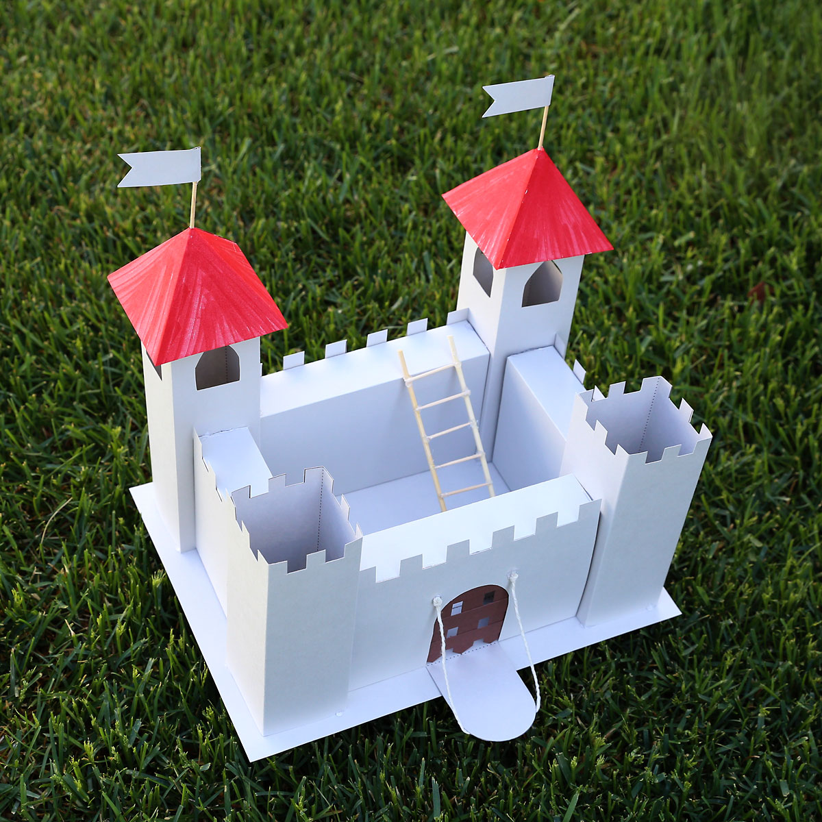 Paper castle sitting on the grass