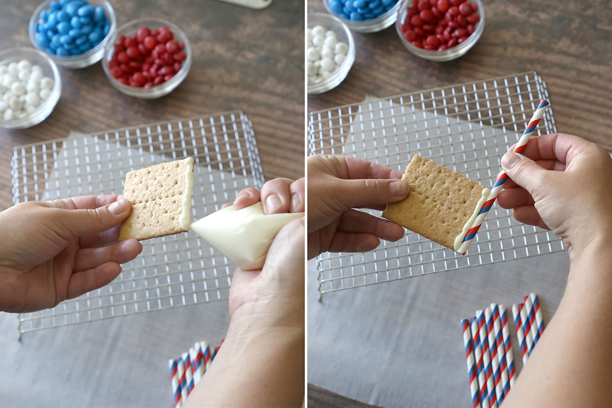 """Graham cracker flags: melted white chocolate """"glues"""" the graham cracker to the straw"""