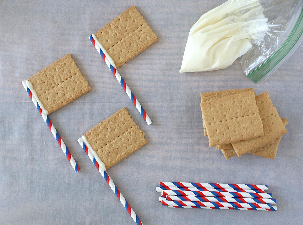 "Graham crackers ""glued"" to straw flagpoles"