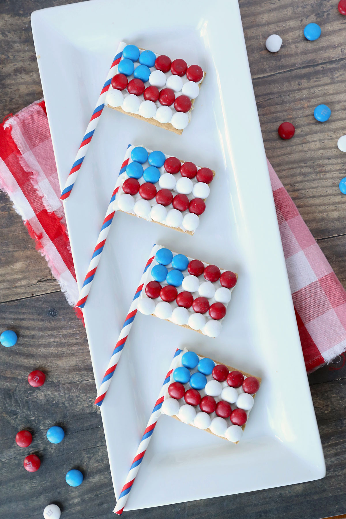 Graham crackers decorated to look like the American flag, with red, white and blue M&Ms on top