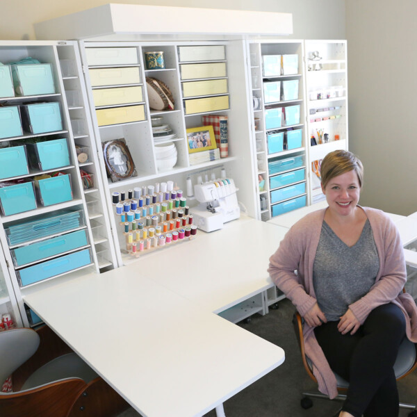 A woman sitting in front of a DreamBox, a craft organization system