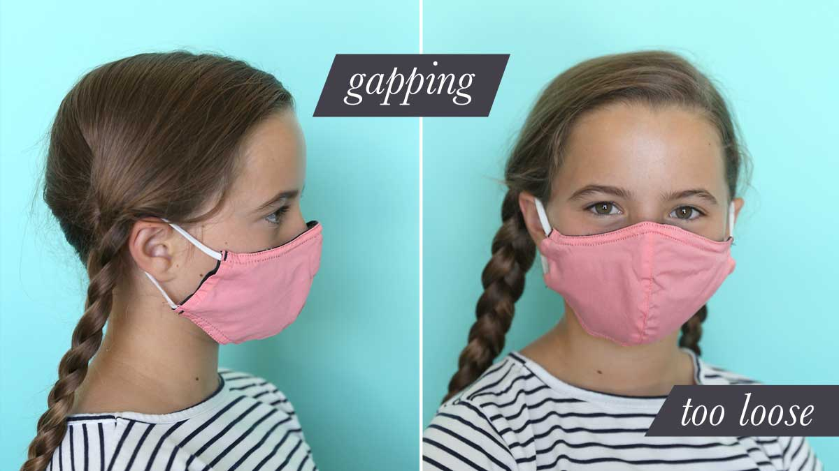 Girl wearing fabric face mask that is too large
