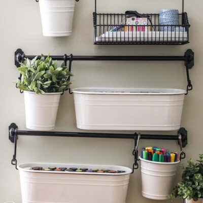 IKEA Fintorp hanging buckets on rails with craft supplies in them