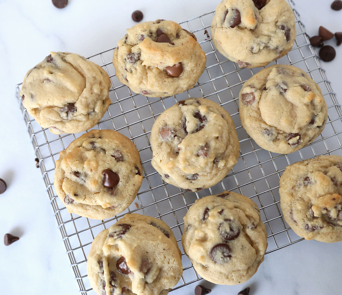Soft, delicious chocolate chip cookies on a cooking rack