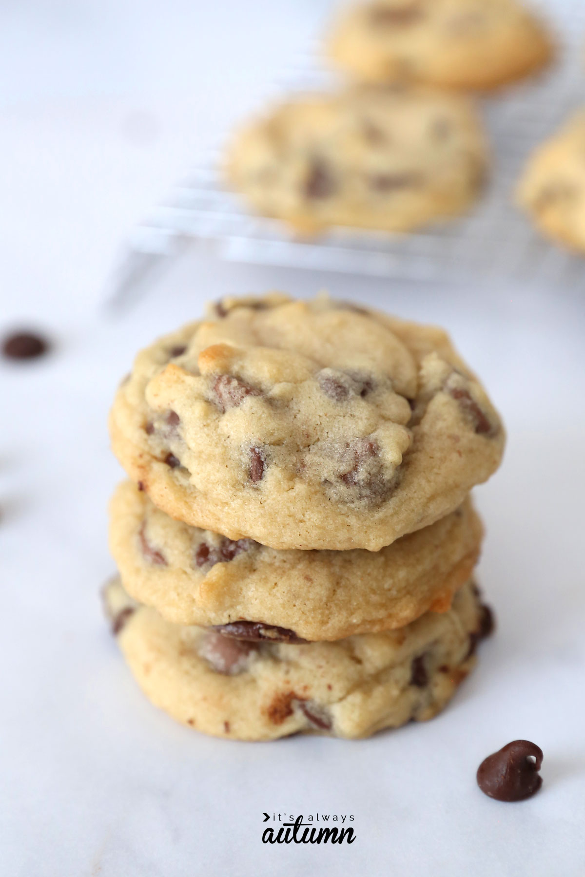 A close up of a stack of soft chocolate chip cookies