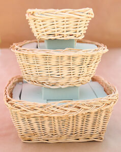 Small basket stacked on top of medium and large baskets
