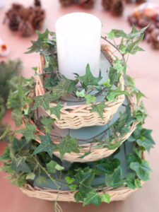 Faux ivy strands wrapped around centerpiece