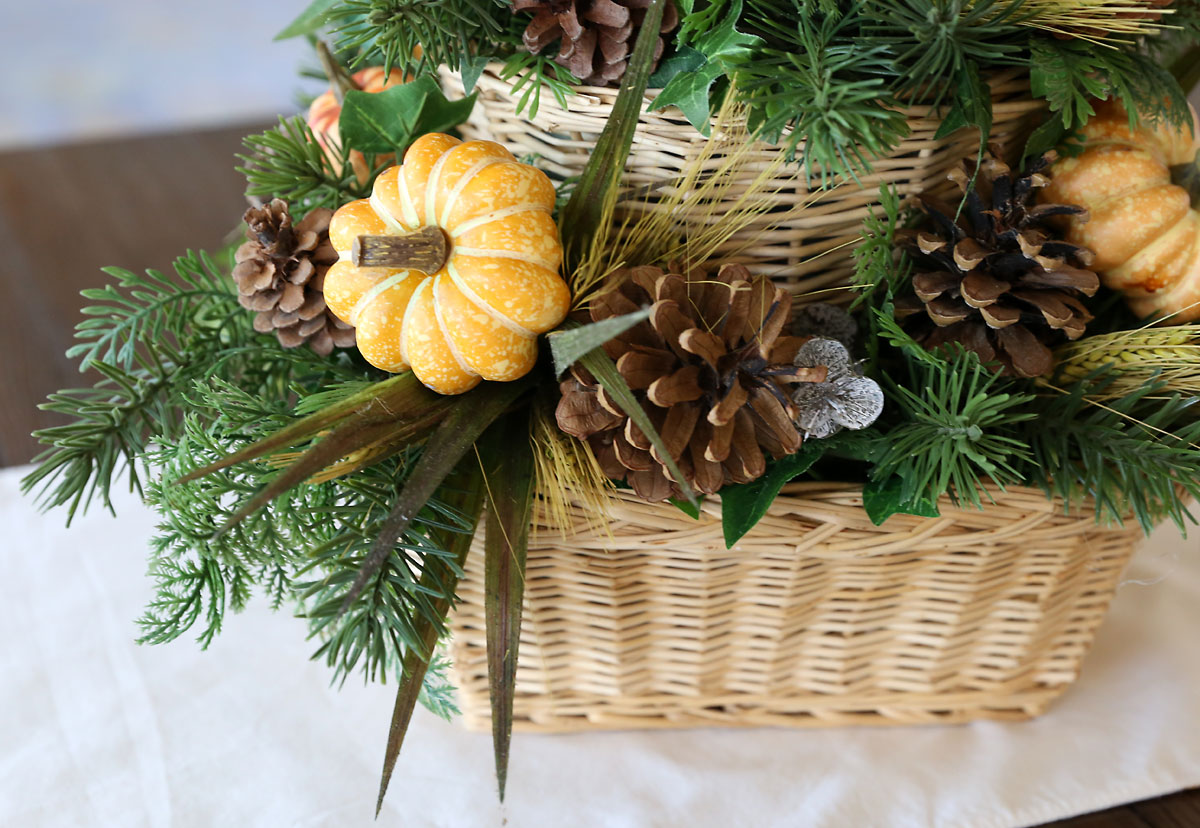 Fall accents on a DIY basket centerpiece