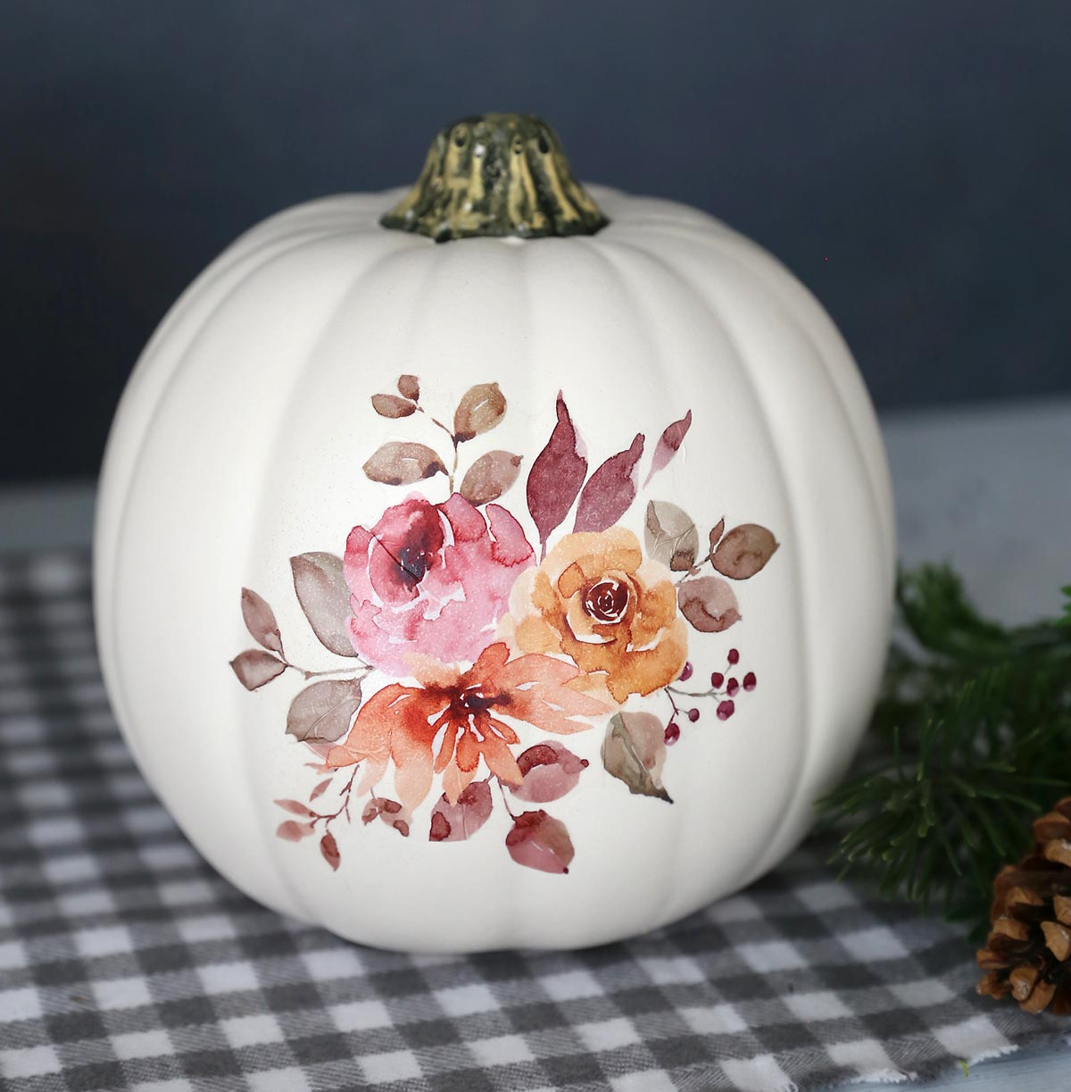 White craft pumpkin with fall floral design transferred onto it