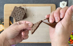Use melted chocolate to glue graham cracker pieces together