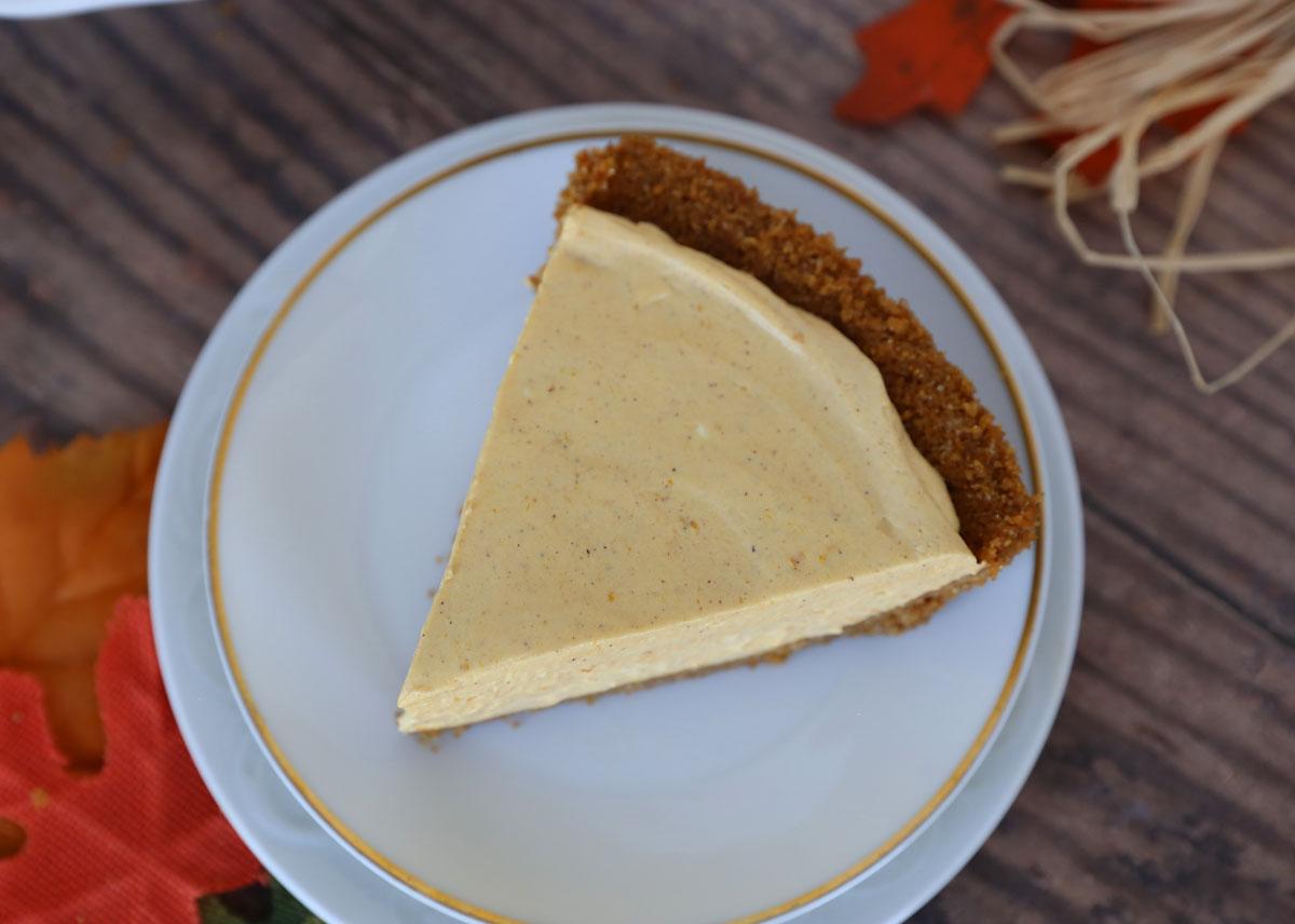 Slice of no bake pumpkin cheesecake on a white plate