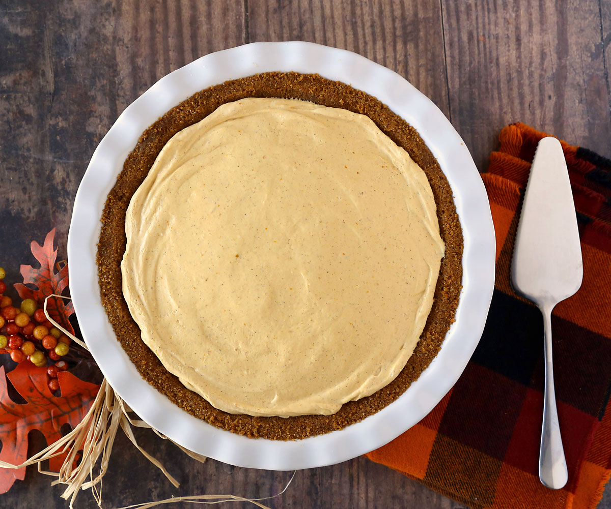 Simple no bake pumpkin cheesecake in a gingersnap crust