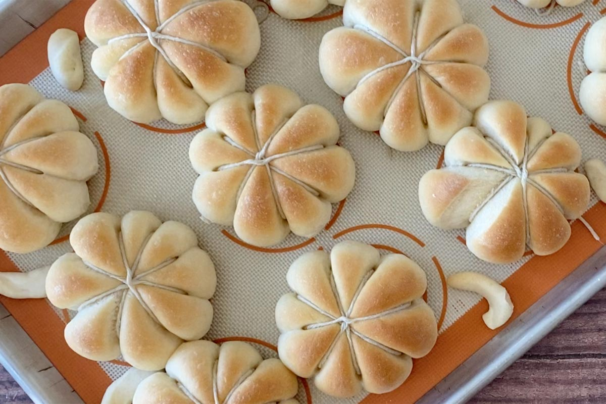 Baked dinner rolls in the shape of a pumpkin