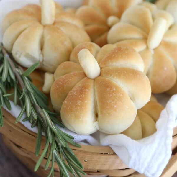 Basket of pumpkin shaped dinner rolls