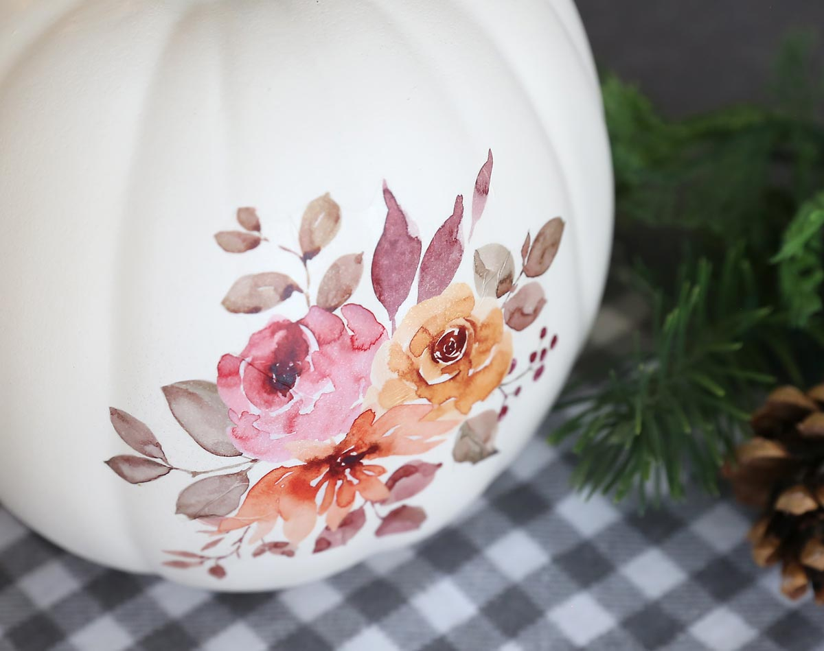 Close up of floral tattoo on a craft pumpkin