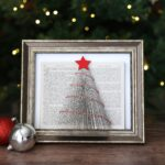 Christmas tree made from a book with folded pages in a picture frame