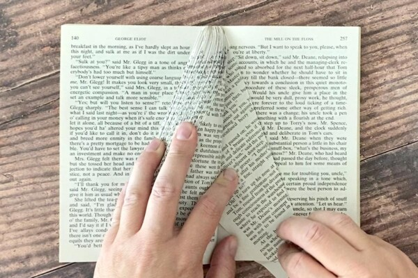 Hold folded pages to the left as you continue to fold pages on the right