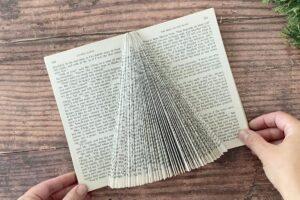 Folded pages create a Christmas tree shape