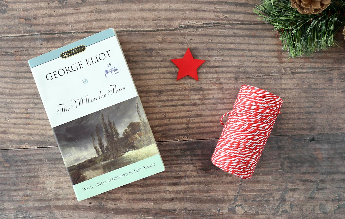 Folded book Christmas tree supplies: old paperback book, star decoration, twine