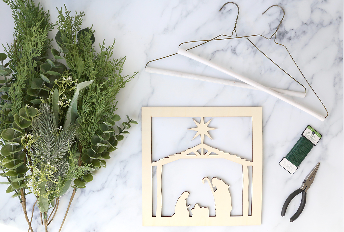 Supplies: Nativity cutout, wire hangers, greenery, floral wire, snips