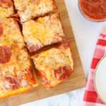 Slices of Detroit style thick crust pan pizza