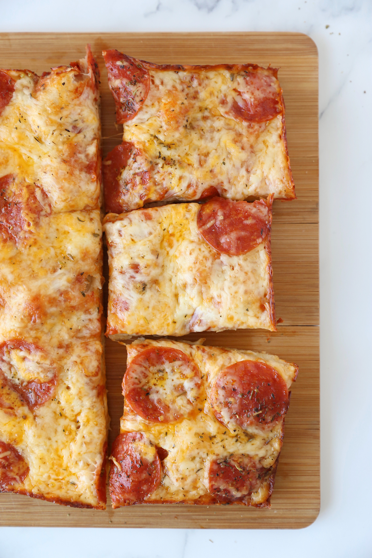 Thick crust pan pizza on a cutting board