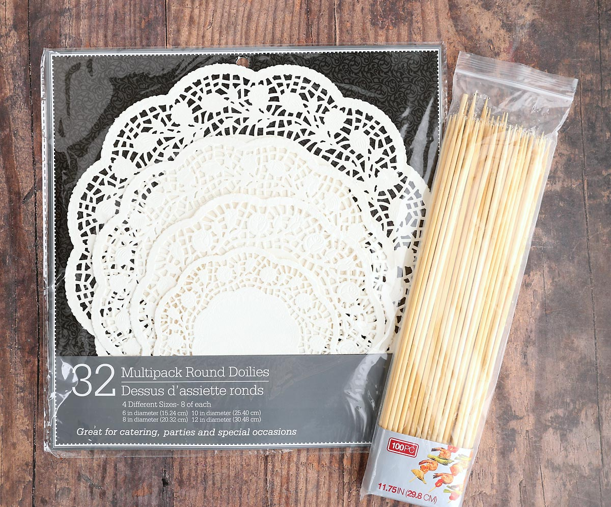 Doily Christmas tree supplies: paper doilies in various sizes and wooden skewers