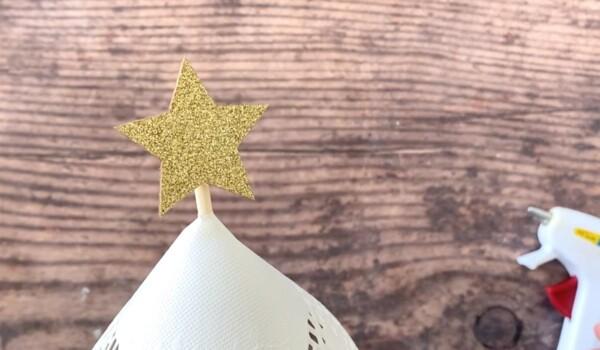 Glue star at top of skewer