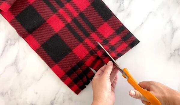 Cut fringe in fleece scarf
