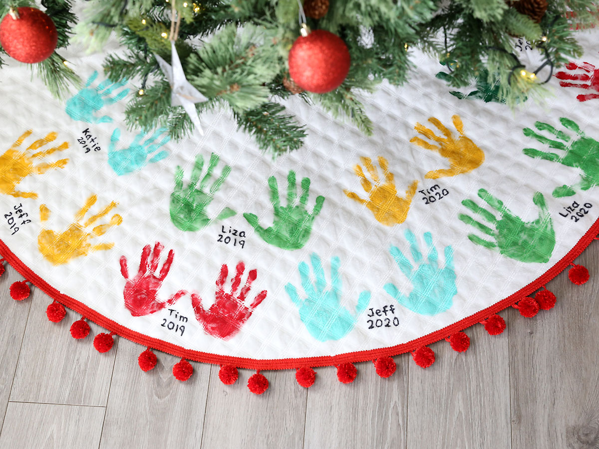 Close-up of handprints on Christmas tree skirt
