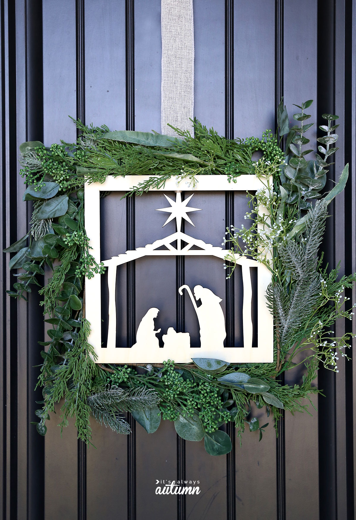 DIY nativity wreath hanging on a front door