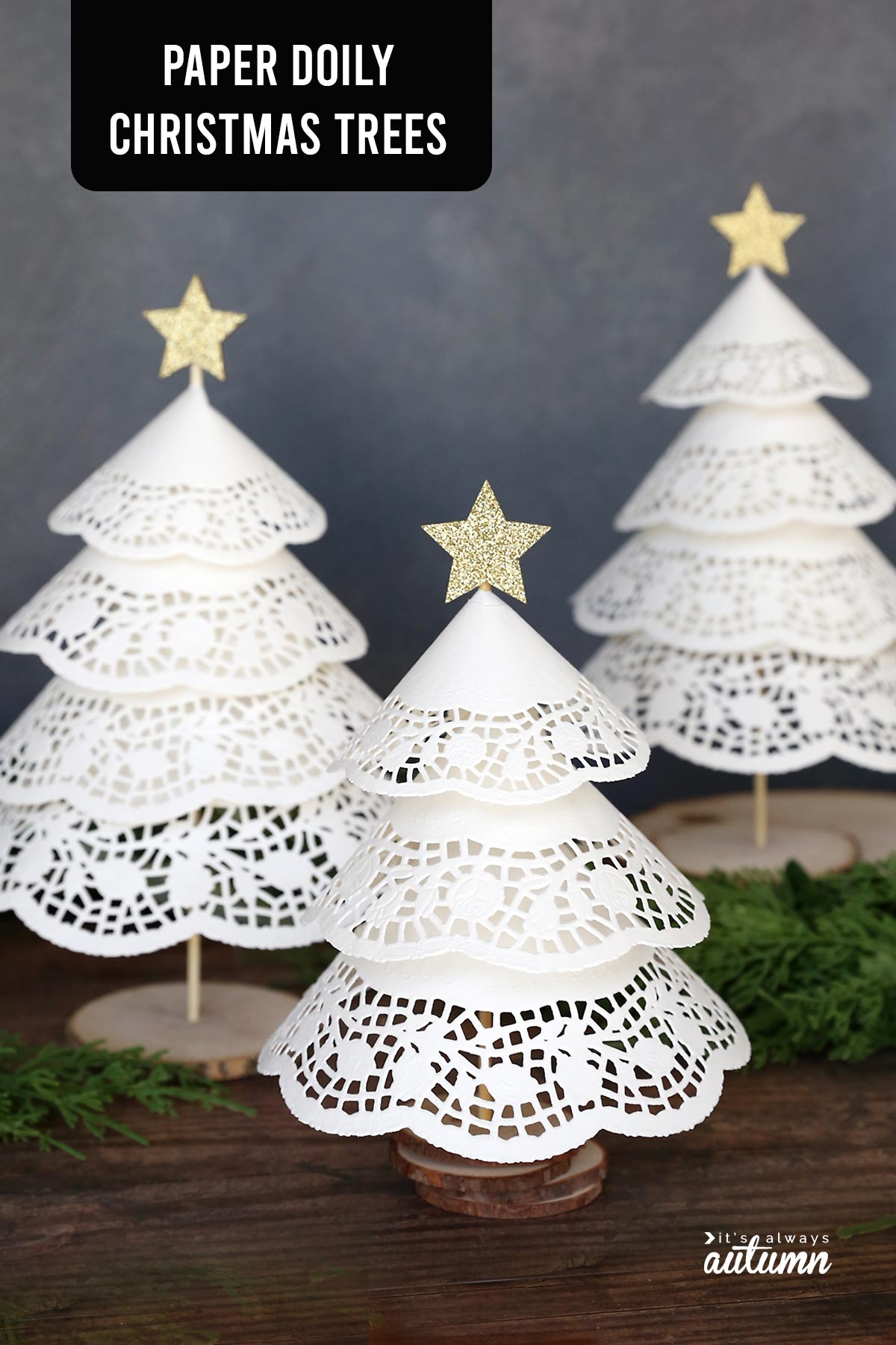 Three white Christmas trees made from paper doilies