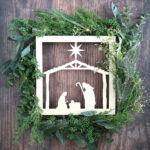 You can make this gorgeous DIY Nativity Wreath by combining an inexpensive nativity cutout with greenery