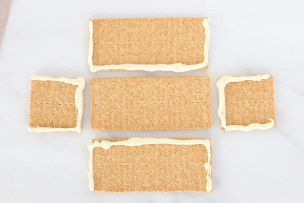 """Graham crackers with melted white chocolate for """"glue"""""""