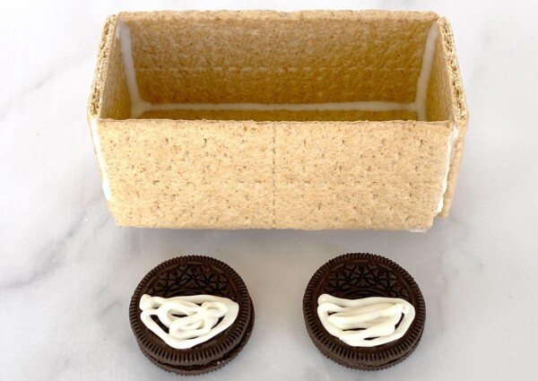 melted white chocolate on Oreos to be glued onto train car