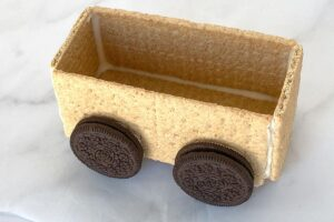 Graham cracker train car with Oreo wheels