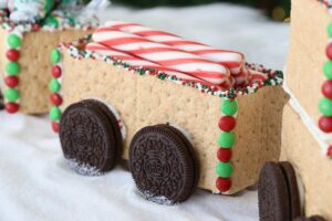 Graham cracker train car decorated with M&Ms and sprinkles