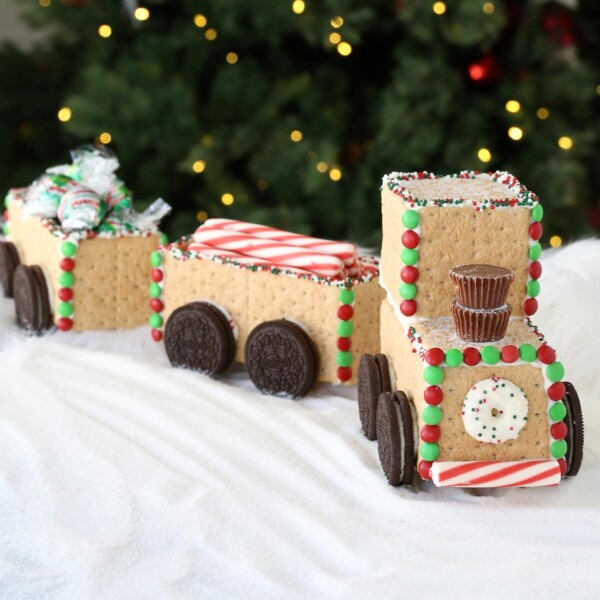 Candy train made from Graham crackers in front of a Christmas tree