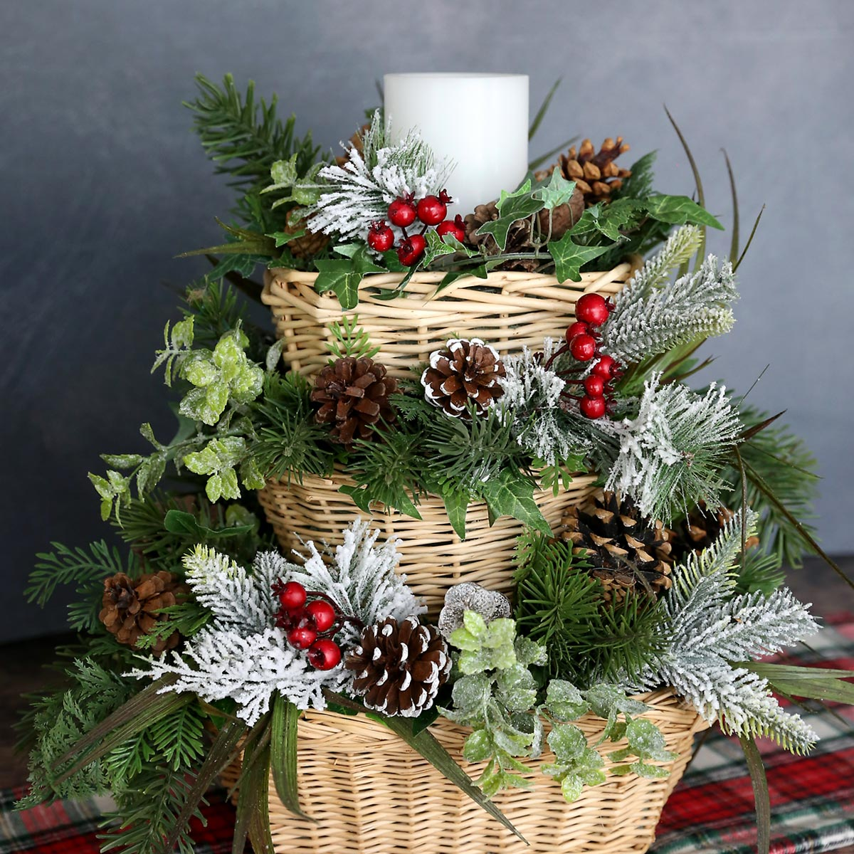 Three level stacked basket winter centerpiece