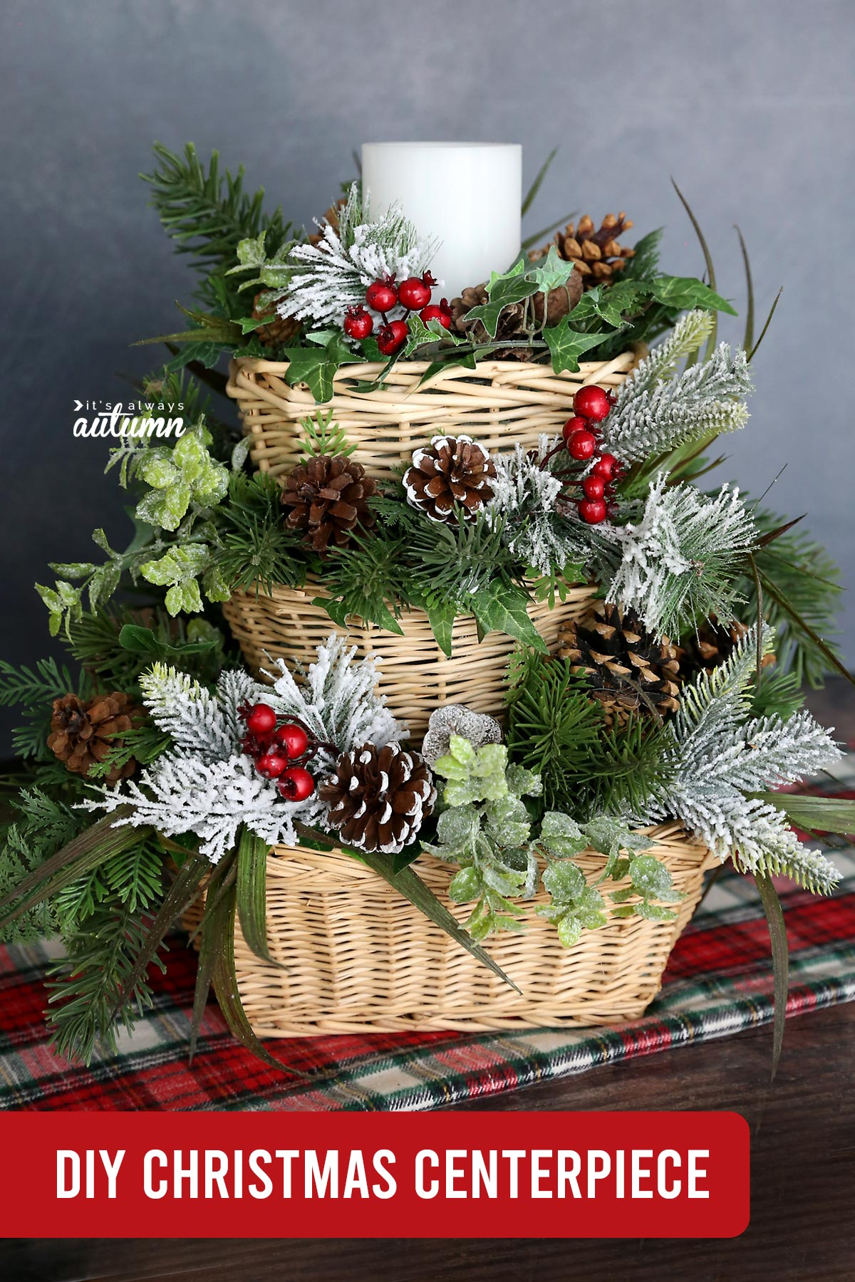 DIY Christmas centerpiece made with three wicker baskets stacked on top of each other and filled in with faux greenery and a candle on top