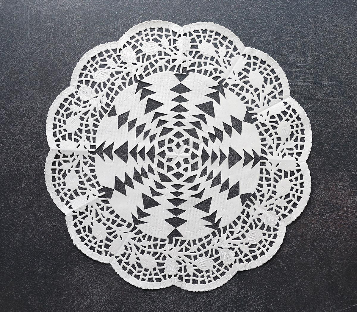 Paper doily cut into a snowflake