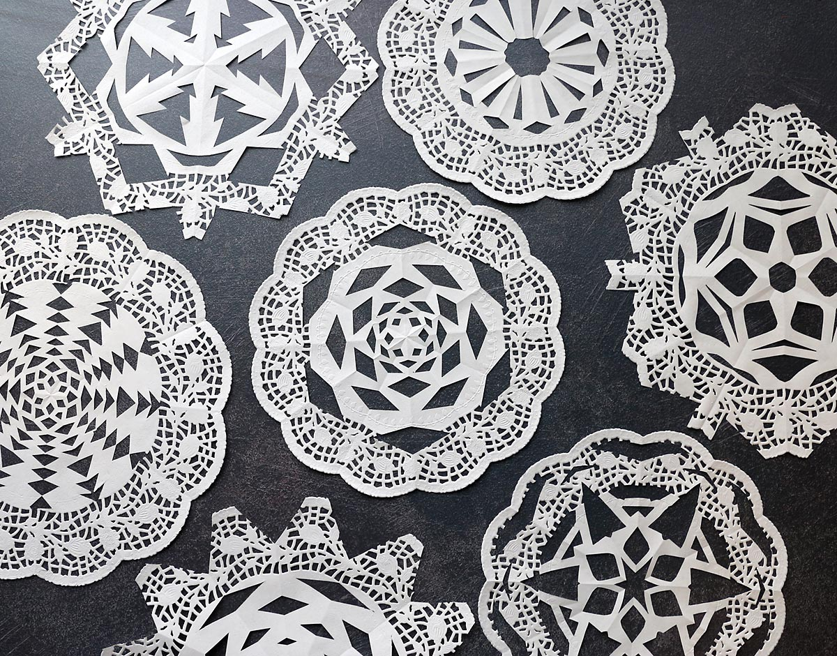 Multiple paper doily snowflakes
