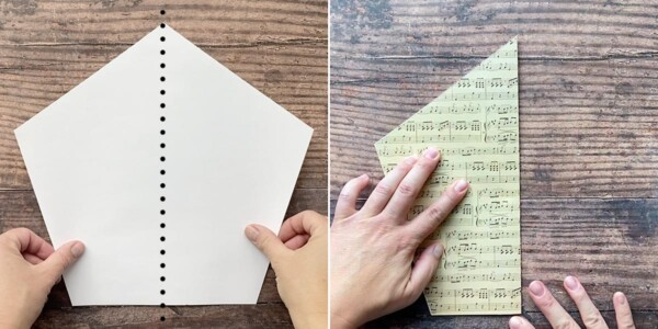 Hands folding paper pentagon in half right to left
