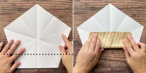 Hands folding bottom edge of paper pentagon up to meet folds
